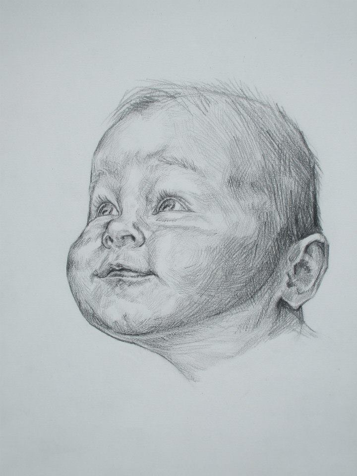 Portrait d\'un bébé concentré 1vendu